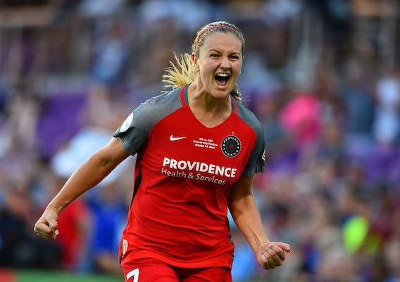 Lindsey Horan scores a goal and celebrates